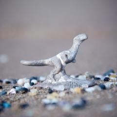 Plastic dinosaur on a plastic landscape