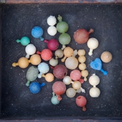 Plastic Pop-it beads, 1950s onwards