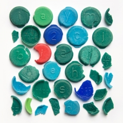 Broken Smartie lids found on  beaches, 14-40+ years old