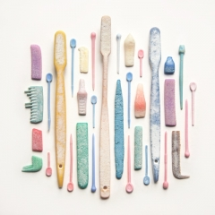 Vintage toothbrushes, hair curler pins & combs